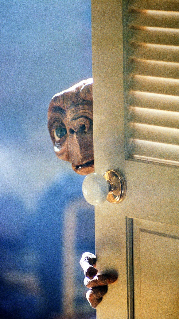 E.T., separated from his own kind, warily explores