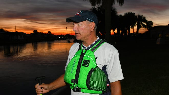 Scott Hoffman of Satellite Beach is upset about the sewage situation. Oars & Paddles Park in Indian Harbour Beach at sunset. The waters had recently had sewage dumped into it during the recent storms and Hurricane Irma.