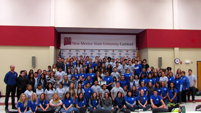 Students, staff and faculty of the Early College High School posed with United Way Director Linda Dodd.
