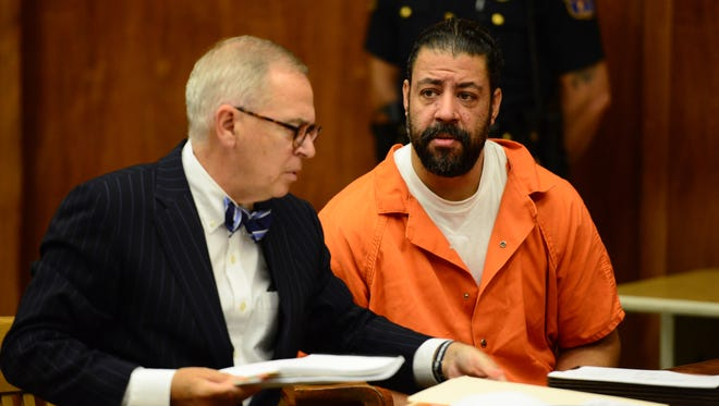 Raphael Lolos, who is accused of killing his girlfriend, sits next to his attorney, Brian Neary, in court in Hackensack on Monday..