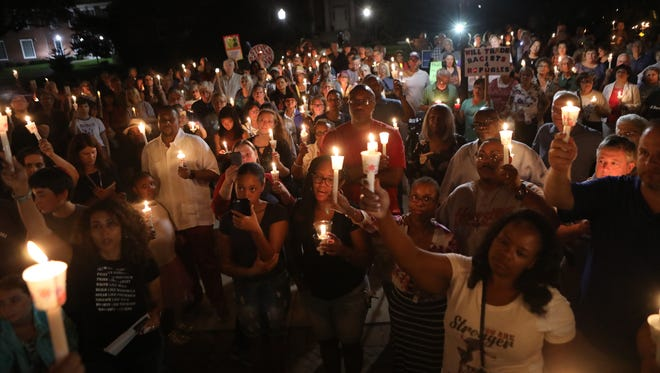 More than 200 people gathered at the green in front of the Teaneck Municipal Building Sunday night to protest the violence in Charlottesville, Va.   Sunday August 13, 2017