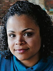 """Christina Fernandez-Morrow, executive director of the Latina Leadership Initiative of Greater Des Moines was part of a roundtable discussion on challenges faced by local female YPs. """"Books tell you to find someone to aspire to, where you want to be. But I found those women were often not where I wanted to be,"""" she said."""