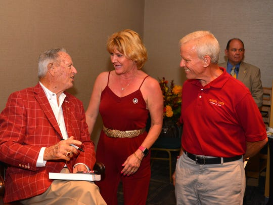 The Brevard Seminole Club presented The Bowden Dynasty film with special guest legendary FSU coach Bobby Bowden at the Kennedy Space Center Visitor Complex Friday night. At a VIP reception, people waited in line to meet the coach and get a photograph taken with him.  Donna and Carl Wasileski get their book autographed by Coach Bowden.