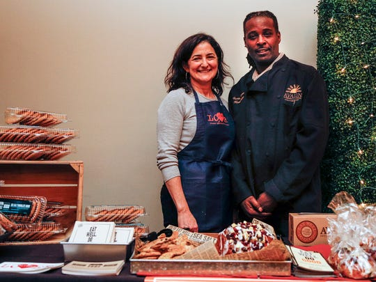 Avalon Cafe & Bakery's co-founder and CEO Jackie Victor, left, and head baker Curtis Wooten pose for a photo.