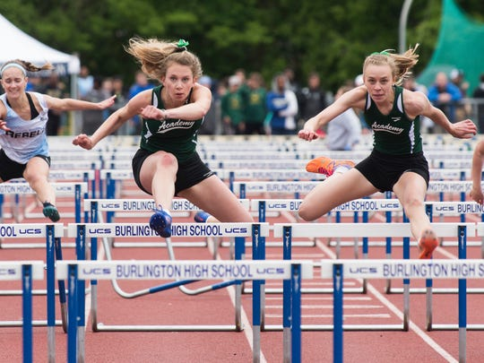 St. Johnsbury's Grace Cooke and Katherine Cowan battle for first place in the girls 100m hurdles finals during the division I high school track and field state championships at Burlington High School on Saturday June 3, 2017 in Burlington. (BRIAN JENKINS/for the FREE PRESS)