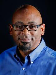 Enquirer senior news director Michael McCarter poses
