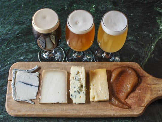 Cheese and beer pairing at Farmhouse Tap and Grill in Burlington on Wednesday, July 6, 2016. From the left, the cheeses are Blue Ledge Lakes Edge, Doe's Leap Trappiste, Jasper Hill Bayley Hazen blue cheese, and Cabot cloth-bound cheddar and a dollop of apple butter. The beers are, from the left, Left Hand milk stout, Hill Farmstead Edward, and Allagash White.