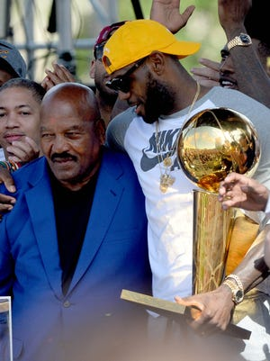 Former Cleveland Browns player Jim Brown, a member of the last team to win a major Cleveland championship stands with Cleveland Cavaliers forward LeBron James during the Cleveland Cavaliers NBA championship celebration in downtown Cleveland.