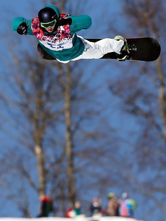 FILE - In this Feb. 8, 2014, file photo, Australia's Scotty James takes a jump during the men's snowboard slopestyle semifinal at the Rosa Khutor Extreme Park, at the 2014 Winter Olympics, in Krasnaya Polyana, Russia. James won't be holding back any punches at the 2018 Winter Olympics in South Korea. He will be wearing boxing gloves when he competes - his not-so-subtle way of reminding himself that any time he drops into the halfpipe, he's in for a brawl. His new trick makes him one of the favorites. (AP Photo/Andy Wong, File)