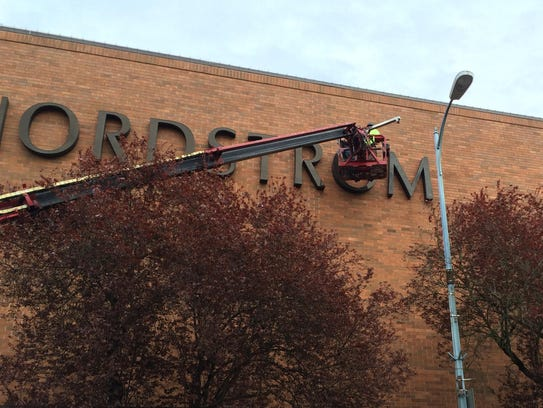 The Nordstrom sign is taken down on the retailers last