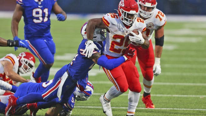 Kansas City Chiefs running back Clyde Edwards-Helaire, right, runs the ball during the first half of an NFL football game against the Buffalo Bills, Monday, Oct. 19, 2020, in Orchard Park, N.Y.