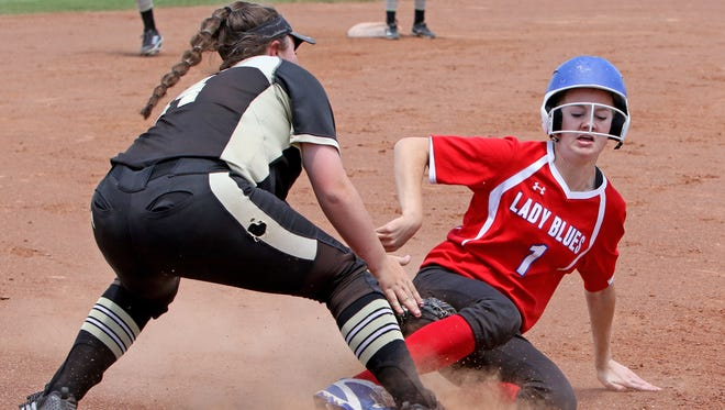 Graham's Ashton Reese is called safe at third under Bushland's McKenna Driver Saturday, May 19, 2018, in Game 2 of the Region I-4A semifinal at Vernon College's Wade Kirk Softball Field in Vernon.