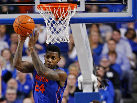 Florida Gators forward Casey Prather (24) rebounds the ball against Kentucky Wildcats guard James Young (1) at Rupp Arena. Florida defeated Kentucky, 69-59.