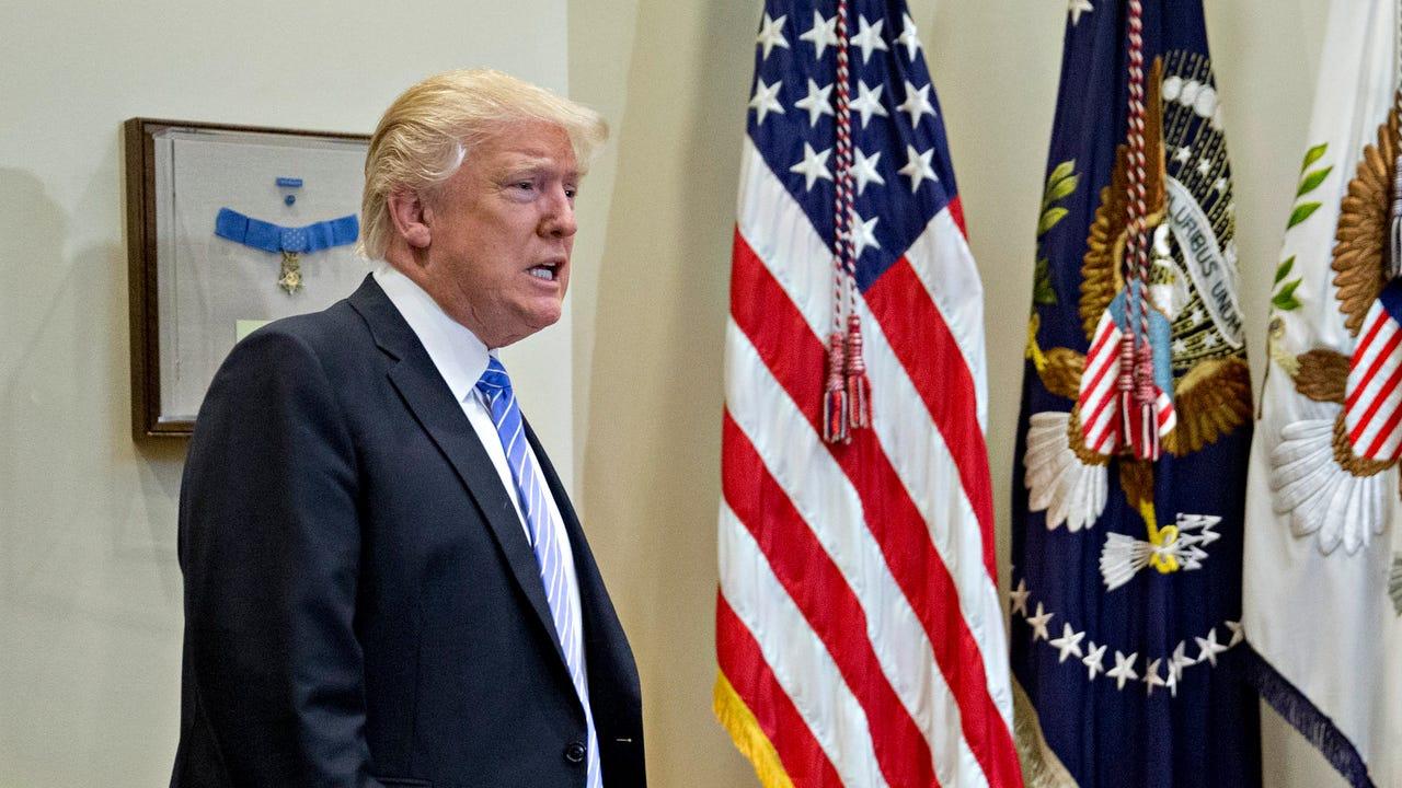 Trump slams intel officials, media over Flynn