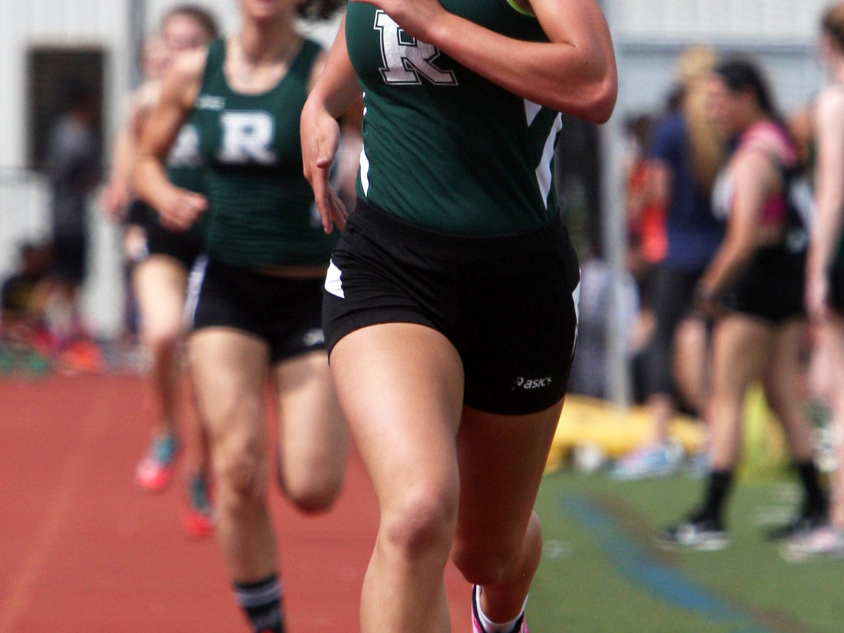 The 2015 Somerset County Track and Field Championships held at Hillsborough High School on Tuesday May 12,2015. Ridge High School's Liz Newman takes the top spot in the girls 1600 meter race.