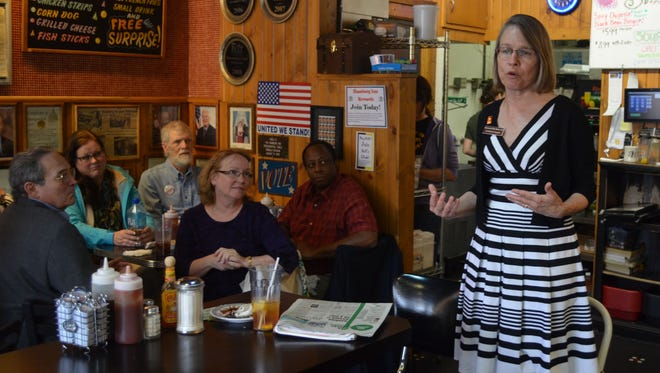 Republican congressional hopeful Mariannette Miller-Meeks speaks to supporters Tuesday afternoon at the Hamburg Inn in Iowa City.