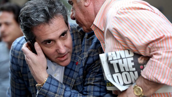 Michael Cohen takes a phone call  as he sits outside near the Loews Regency hotel on Park Ave on April 13, 2018 in New York.