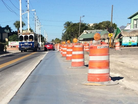 Steel plates have been placed over the median on Estero Boulevard in Fort Myers Beach to prevent more from being damaged as traffic is diverted to mid-road during construction.