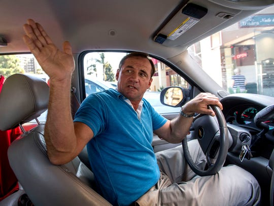Wes Lewison sits in his vehicle on Friday, Sept.  15,