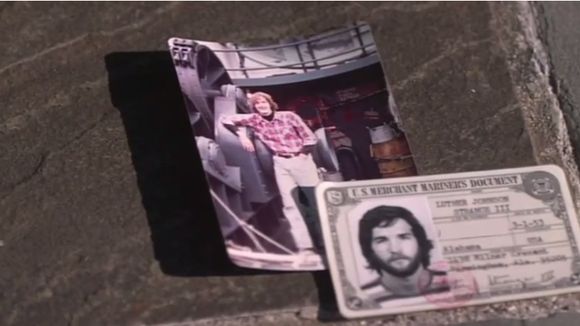 Luther Strange's seaman's card displayed with a contemporary photo in a 2010 campaign video. Strange served in the Merchant Marine for a year in the 1970s.