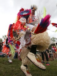 Grand entry of dancers competing at the Bear Mountain