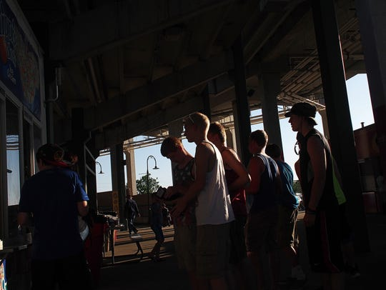 Fans line up in front of a concession stand before