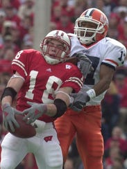 Jim Leonhard intercepts a pass intended for Illinois'