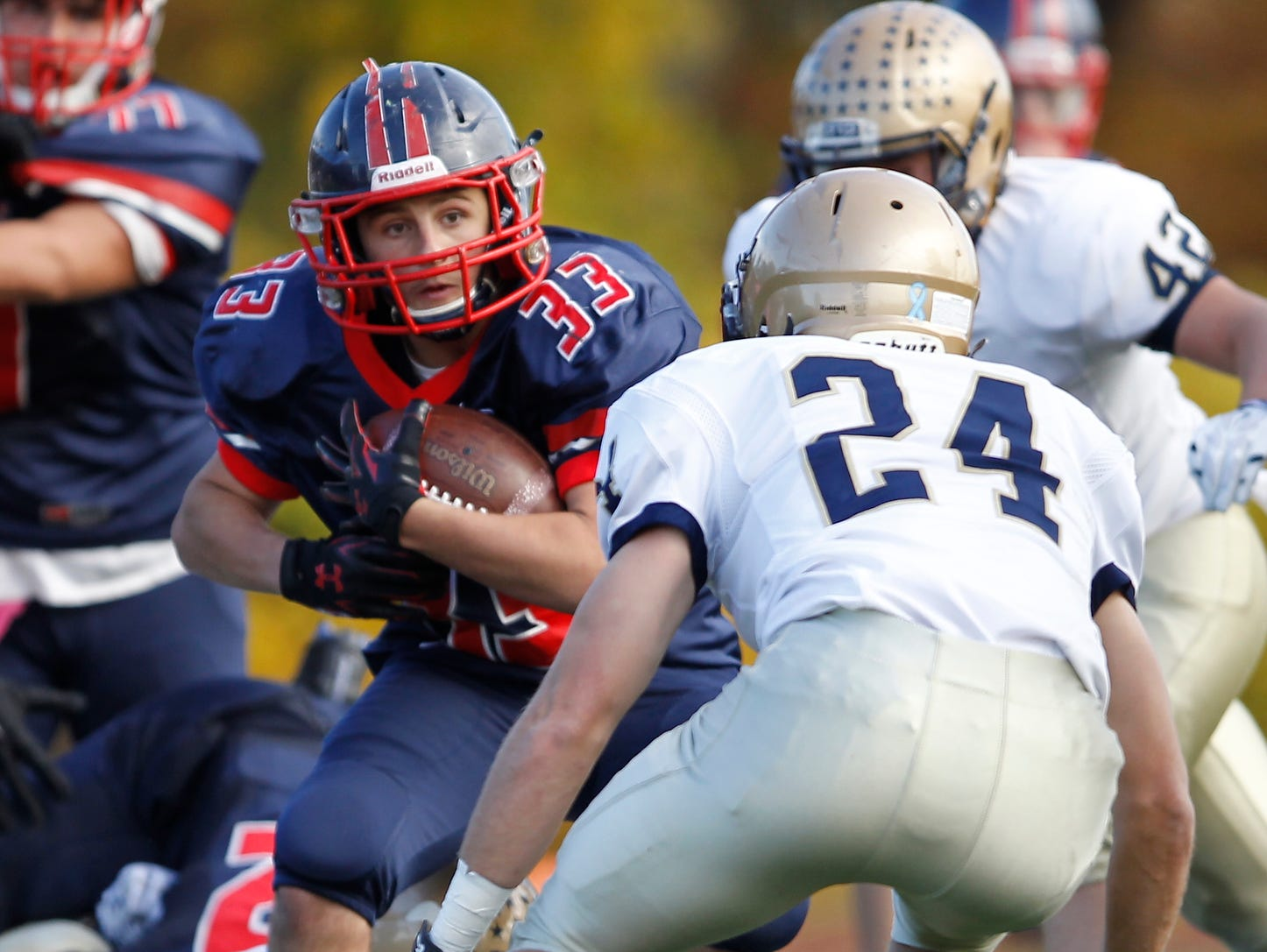 Eastchester's John Guido (33) finds a hole during their 19-27 loss to Our Lady of Lourdes High School in the class A semi-final football game in Eastchester on Saturday, Oct. 31, 2015.
