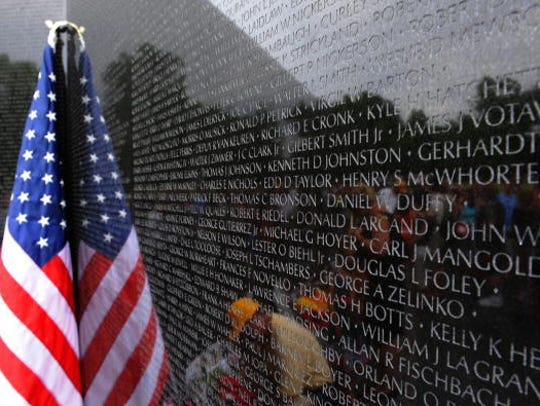 A US flag leans against the National Vietnam Veterans