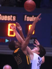 NCC forward Brendan Luken tries to block the shot of