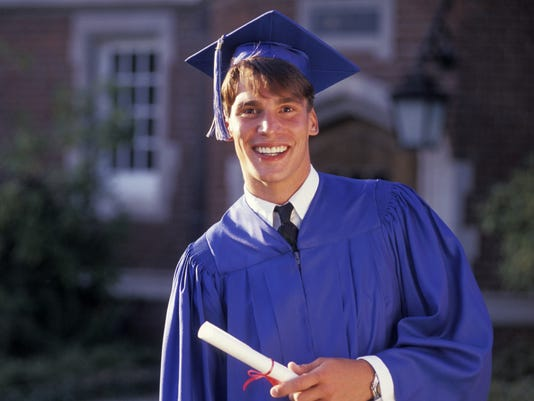 Graduate Smiling And Holding Diploma