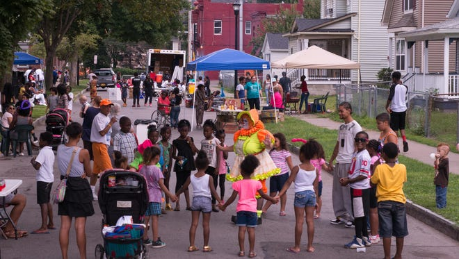 Neighbors of all ages turned out last weekend for a block party on Weld Street. It was the first that many longtime residents could remember there.
