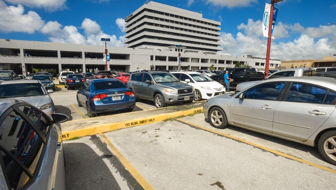 A space for building guests is vacant in the parking lot behind the International Trade Center in Tamuning on Dec. 15.