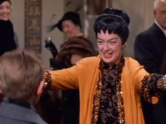 "Rosalind Russell is a dynamo in the title role of ""Auntie Mame"" (1958), now on Blu-ray for the first time."