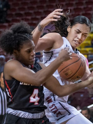 New Mexico State's Jeneva Toilolo, right, and Seattle's McKenzi Williams fight for the loose ball during fourth quarter action Sunday afternoon at the Pan American Center.