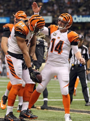 QB Andy Dalton led the Bengals back into first place in the AFC North.