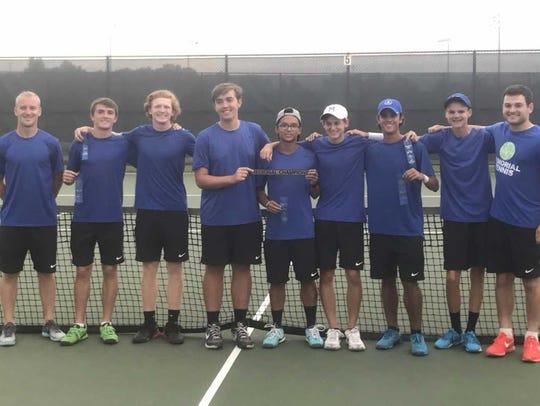The Memorial boys tennis team celebrates winning the