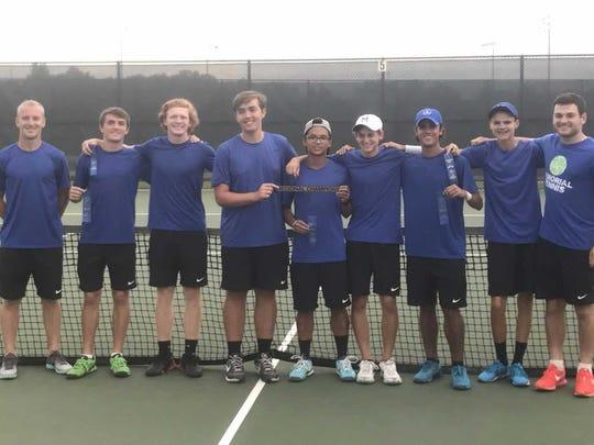 The Memorial boys tennis team celebrates winning the regional against Mater Dei.