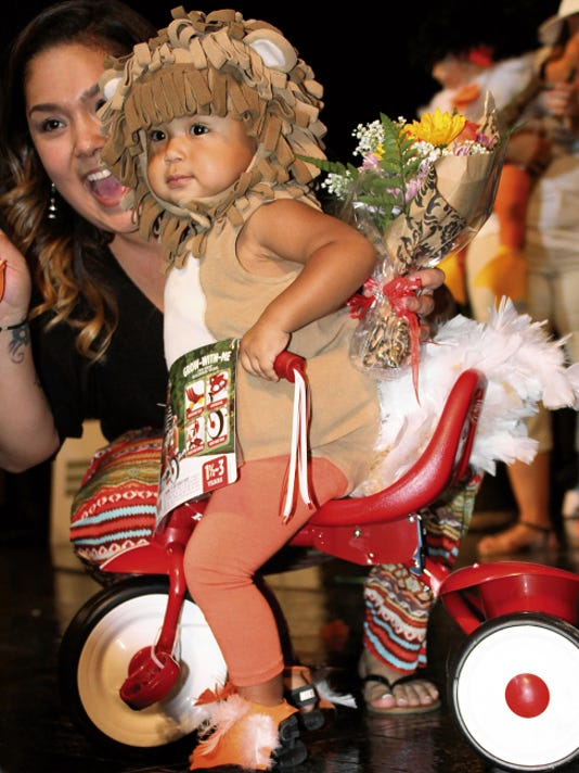 Bill Armendariz - Headlight Photo   Little Luck Chuck won the Just Hatched Division (first 12 months) of the Mizkan Duck Royalty Pageant Thursday night at the Deming Public Schools Auditorium. Aiden Nieto was excited for his new tricycle.