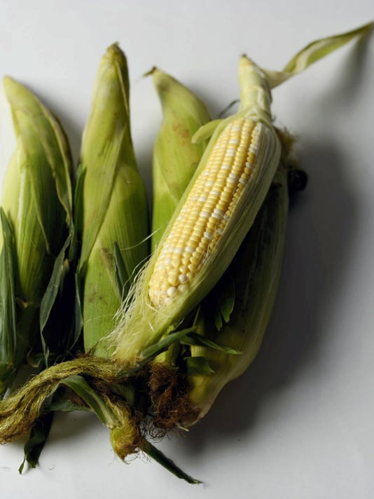 Corn is higher in carbohydrates and sugar than most vegetables but pairs well with other healthful foods to complement a nutritionally balanced diet. Photo taken in studio Aug. 4, 2015.
