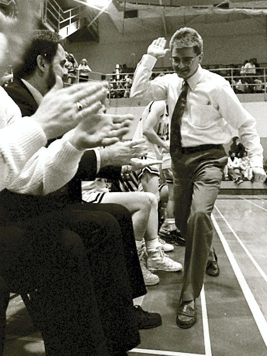 Former Red Lion head girls' basketball coach Tory Harvey high-fives an assistant coach in the final moments of his team's victory against Sun Valley in the PIAA tournament on Friday, March 13, 1992. It was the Lions' first win in the state tournament.