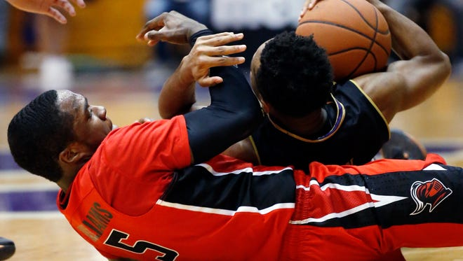 Northwestern guard Isiah Brown, right, battles for a loose ball against Rutgers guard Mike Williams