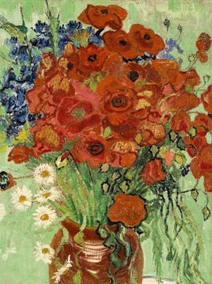 """This undated file photo provided by Sotheby's shows Vincent van Gogh's """"Still Life, Vase With Daisies and Poppies.""""  One of the few works sold during his lifetime and was painted weeks before his death; the painting could sell for up to $50 million when it goes up on the block at Sotheby's on Tuesday."""