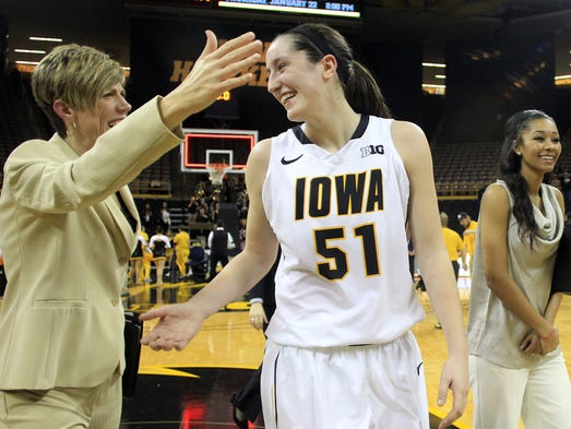 Iowa's Bethany Doolittle gets a hug from associate