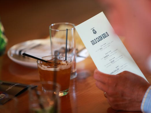 Bob Heimbuch of Grosse Pointe Park looks over the menu