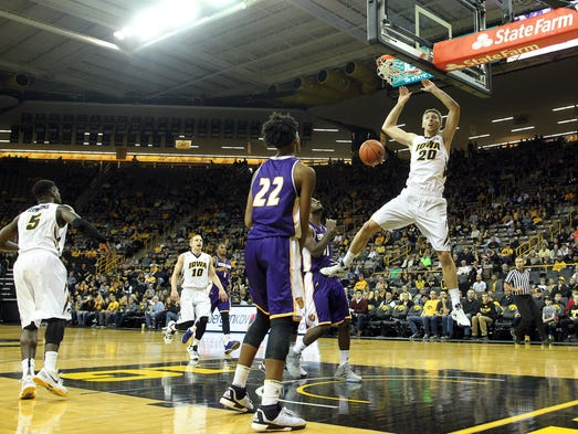 Iowa's Jarrod Uthoff dunks the ball during the Hawkeyes'