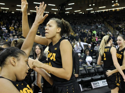 Iowa's Chase Coley high-five's teammates following