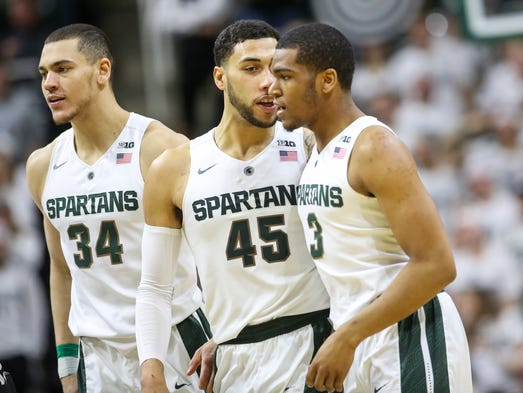 Michigan State Spartans Denzel Valentine talks with