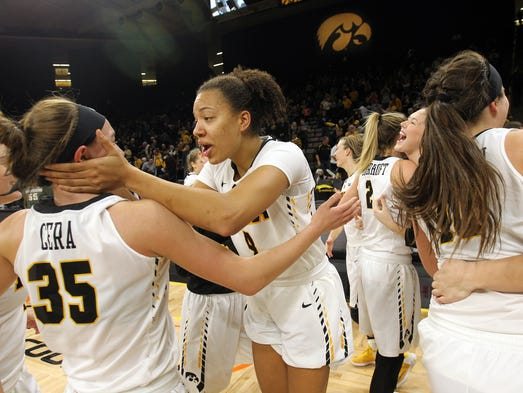 Iowa's Chase Coley and Bre Cera celebrate their 87-83