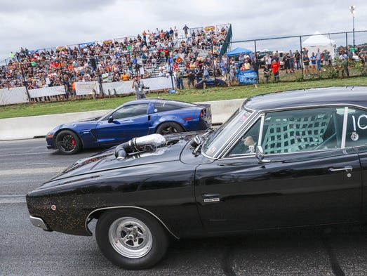 Amateur drag racers compete on a closed section of